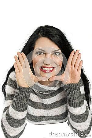 Happy woman framing face