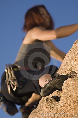 Woman Free Climbing, (close-up), (low angle view)