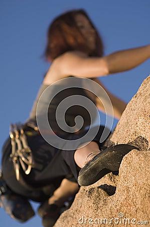 Woman Free Climbing, (close-up), (low angle view)