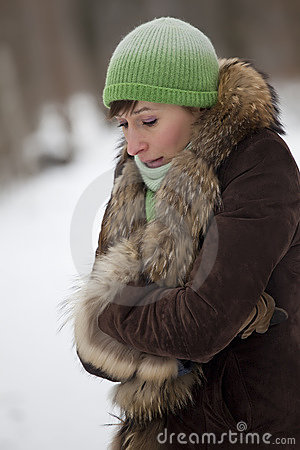 Woman freezing in winter