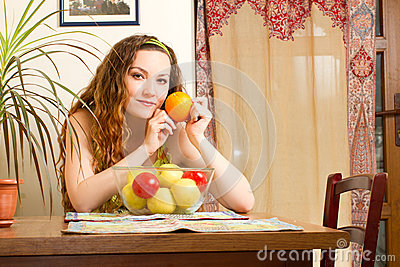 Woman with fresh fruit on the house kitchen.