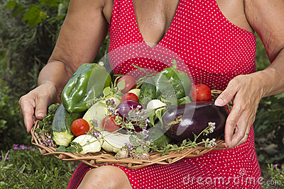 Woman with fresh picked vegetables