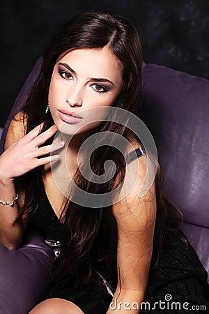 Woman in frock on sofa