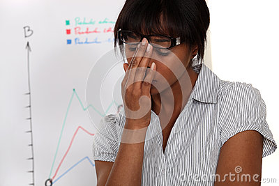 Woman in front of chart