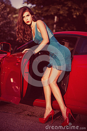 Woman in front red car