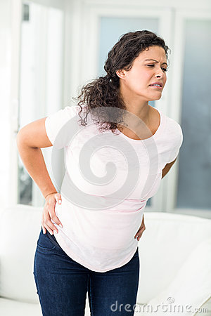 Free Woman Frowning In Back Pain Royalty Free Stock Photo - 60553125