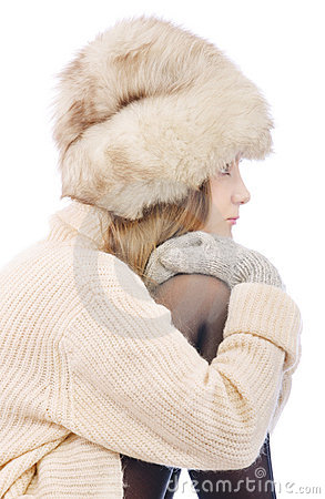Woman in fur cap and sweater