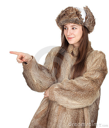 Woman in a fur coat and hat pointing