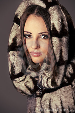 Woman in fur jacket with hood