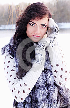 Woman in a fur vest