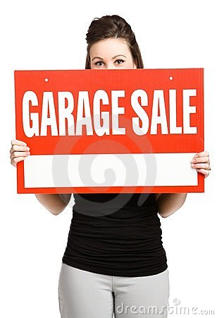 Woman and garage sale sign