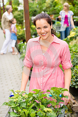 Woman at garden centre shopping for flowers