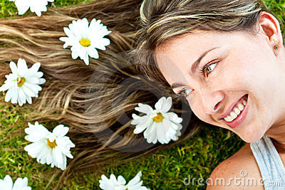 Woman in a garden of daisies