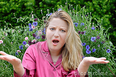 Woman in garden gesturing