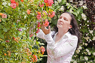 Woman in garden rose check disease