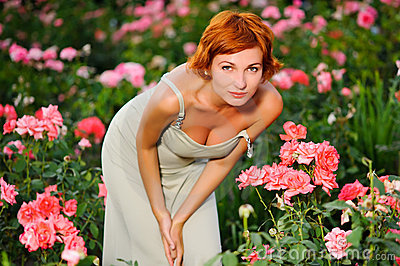 Woman in a garden of roses