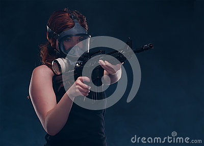 Woman in gas mask with a assault rifle