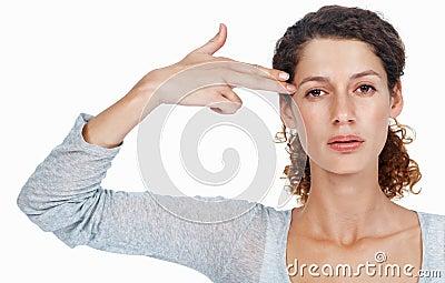 Woman gesturing gun
