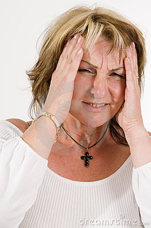 Woman gesturing headache