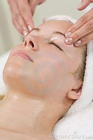 Woman Gets Relaxing Head Massage or Facial At Spa