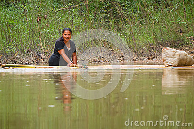 Woman getting across the river with the raft Editorial Stock Photo