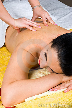 Woman getting back massage at spa