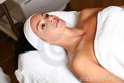 Woman getting cream spa lotion