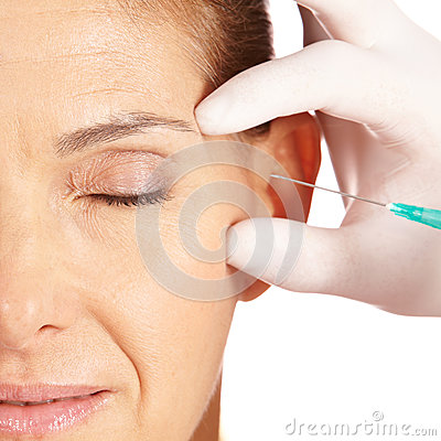 Free Woman Getting Crows Feet Removed Stock Photo - 24863000