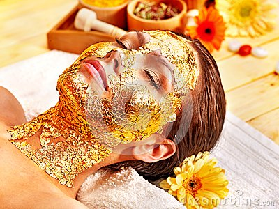 Woman getting  facial mask .