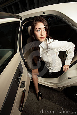 Woman getting out of her car