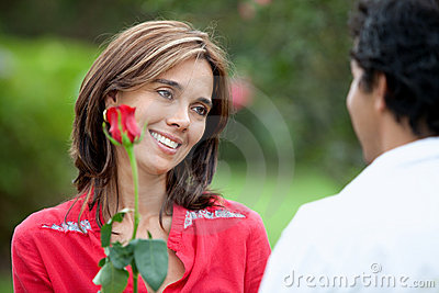 Woman getting a red rose