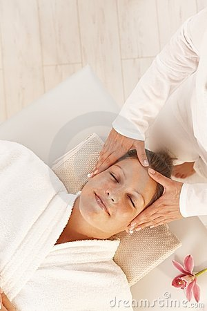 Woman getting relaxing head massage