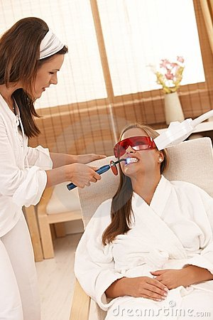 Woman getting tooth whitening