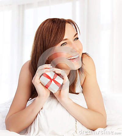 Woman With Gift Stock Image - Image: 29001571