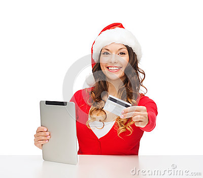Woman with gift, tablet pc and credit card