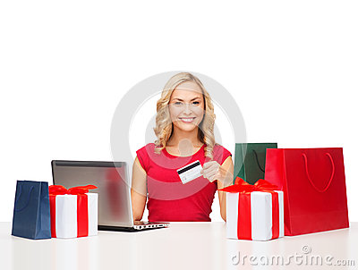 Woman with gifts, laptop computer and credit card