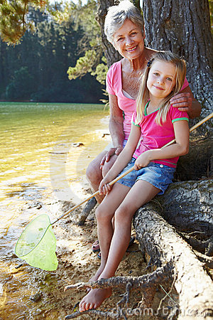 Woman and girl fishing together
