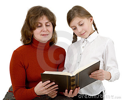 Woman and girl reading book