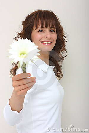 A woman give a flower