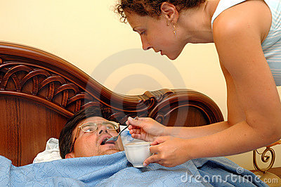 Woman gives drink to sick man