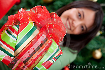 Woman giving a Christmas gift