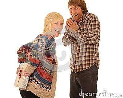 Woman giving man present