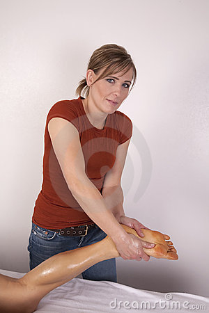 Woman giving massage on foot