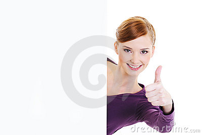 Woman giving thumbs-up with blank banner