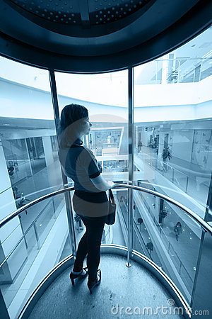 Woman in glass elevator