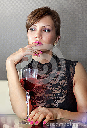 Woman with glass of wine ll