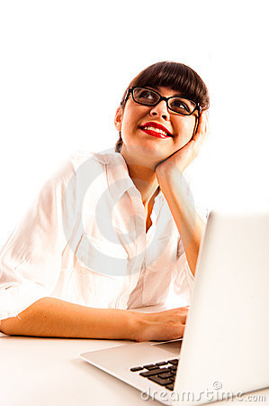 Woman with glasses, contemplating with a laptop.