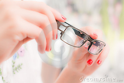 Woman with glasses in hands