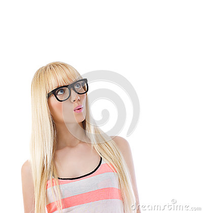 Woman in glasses looking up at copyspace