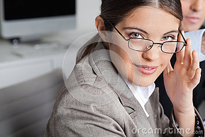 Woman with glasses in the office